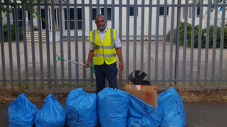 Mohammad Fayyaz with some of the rubbish we collected in Asheridge Road